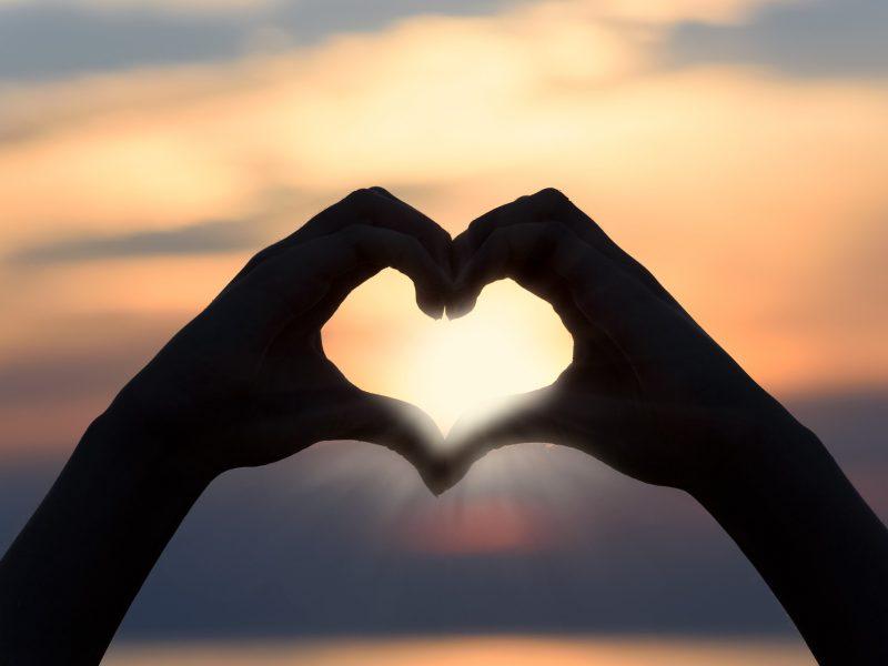 sunset heart hands